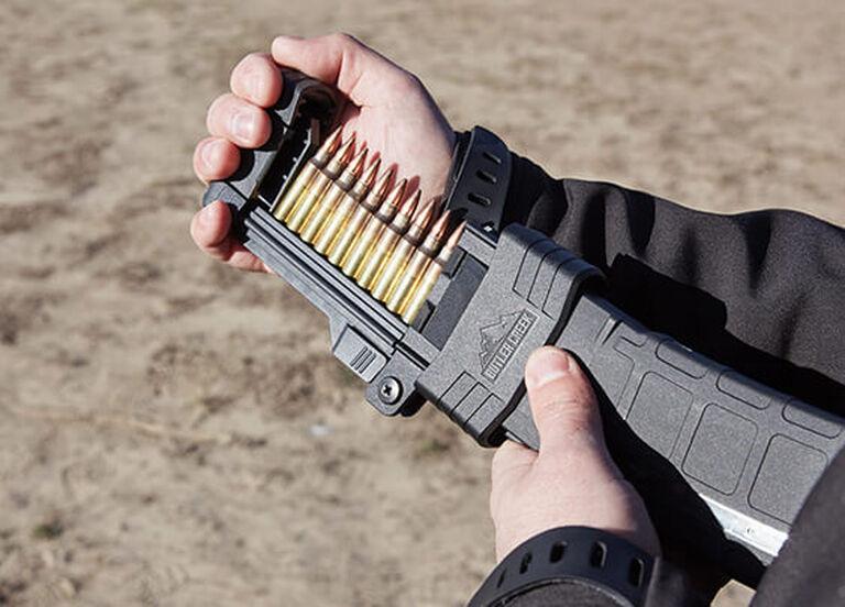 Hand loading a rifle magazine